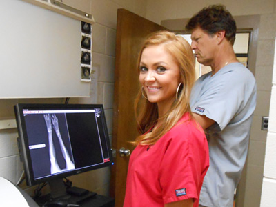 Surgery assistant LeAnn studying x-rays.